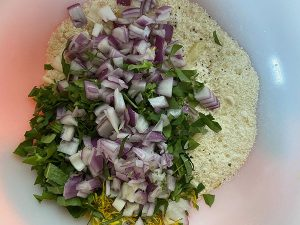 Red onion, Dandelion and Chickweed, and flour in a bowl